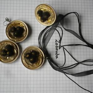 parure dorée en capsule  de café