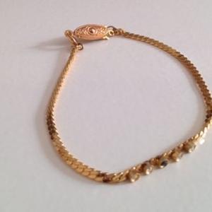 bracelet doré à strass