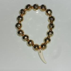 bracelet doré dent requin